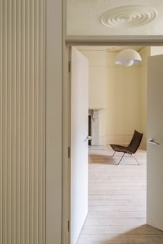 Storage is built into the hallway, beside double doors leading into the living room. Sunken Patio, Red Brick Walls, Pink Tiles, Victorian Buildings, Exterior Cladding, London House, Room Tiles, Victorian Design, House Extensions