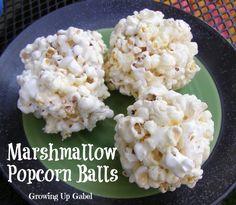 Marshmallow Popcorn Balls from Growing Up Gabel #popcorn #recipe #Halloween