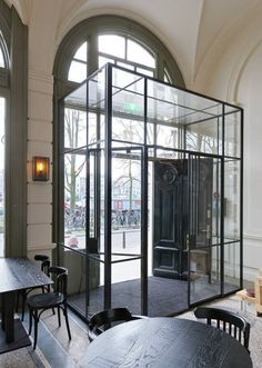 I think this glass entrance to a restaurant is clever as often if you are sat near a door you get a blast of cold when people walk in! It is also contrasted against the older entrance door