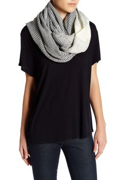 A warm and cozy infinity scarf detailed with a chic herringbone design, a must-have for those chilly fall days!