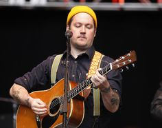 Isaac Brock. He's -sssooooo- cute in his button up, suspenders and hat <3