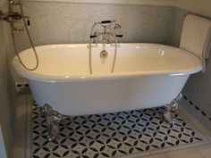 love the idea of using a painted cement tile pattern just around the tub, and then a field tile elsewhere.