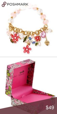 """Betsey Johnson Flower & Pearl Stretch Bracelet NWT AUTHENTIC Betsey Johnson crystal flower & pearl stretch bracelet is ready for gift giving in beautiful Betsey Johnson pink gift box!  FEATURES: glass crystal flowers half stretch design mixed faux pearl and plastic faceted beads multiple charms  SIZE: approx. 7.5"""" length 0.5"""" width Betsy Johnson gift box included Betsey Johnson Jewelry Bracelets"""