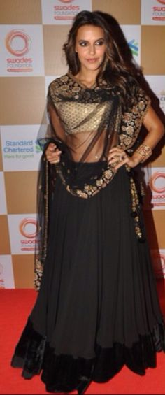 Beautiful and Simple gold and black lehenga worn by Neha Dupia!