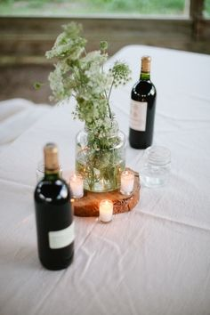 """incorporating wine bottles & tea lights in simple table decor """"#Ruffled for #TheLab2013: http://ruffledblog.com/the-lab-event-giveaway"""""""
