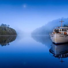 Dawn light, fog and the moon over the Pieman River and the Arcadia II – the world's oldest Huon pine passenger boat still in use – thanks to @loicleguilly.