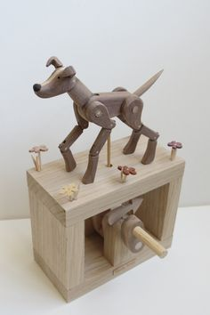 Mechanical wooden dog crafted toy.