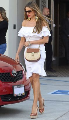What to Wear to a Summer Party | People - Sofia Vergara in a white off-the-shoulder mini dress, wicker bag and platform heels
