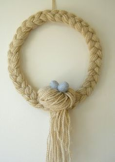 Make a braided yarn wreath. Reminds me Rapunzel.