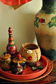 Haat pakha (hand held palm leaf fan), Kansa'r Bason (metal utensils) or Dhama (cane baskets)
