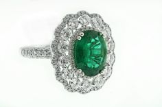 3.35ct Oval Cut Emerald and Diamond Halo Ring GIA certified