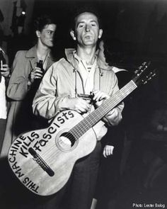 Woody Guthrie: looks like he's in the Clash in this pic, if the Clash were in America 1940