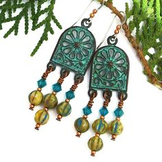 """Reminiscent of the famous Rose Window in Notre Dame Cathedral, Paris, the aptly names NOTRE DAME handmade chandelier earrings are fun and flirty, showing your definite boho side. The earrings feature ornate Mykonos """"rose window"""" charms, rustic Czech glass melon beads and Swarovski crystals."""