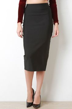 @modaonpoint This pencil skirt features a thick bandage knit fabrication, high rise waist, stretchy sculpture silhouette, midi length hemline, and a vent slit at back. Accessory sold separately. Made in U.S.A. 90% Polyester, 10% Spandex.