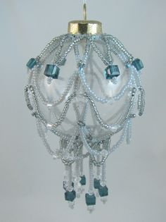 Featured in Bead Magazine Dec.2004 Designed by Anna Elizabeth Draeger -the larger bi-cones were changed with cubes