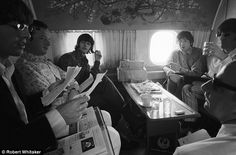 Candid moment: Whitaker was able to take behind-the-scenes shots of The Beatles. here the band are seen relaxing on a flight from Hong Kong to Manila during their 1966 world tour. Pictured clockwise from left are George Harrison, manager Brian Epstein, Ringo Starr, Paul McCartney, John Lennon and chauffeur Alf Bicknell