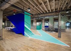 Leeser Architecture inserted angular and brightly coloured stairwells into an old brick building in Brooklyn to create a vibrant co-working space