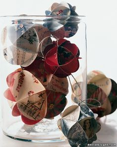 Card Ornaments: Make holiday ornaments from old Christmas cards. Its such a perfect and meaningful way to upcycle your old greeting cards.  Source: Martha Stewart