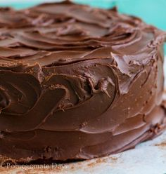 Decadent recipe for Whiskey-Fudge-Cake topped with a dark chocolate ganache.