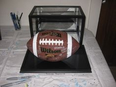 Signed Football as a Baby Shower Guest Book - LOVE THIS or basketball (whichever is the parents favorite)