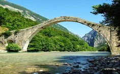 The famous one-arched Plaka Bridge in Hepirus, Greece, that recently collapsed due to heavy rain, by Vassiliki Katsarou Arch Bridge, Greece Travel, Amazing Architecture, Holiday Destinations, Oh The Places You'll Go, The Good Place, Bridges, Cyprus, Travel Guide