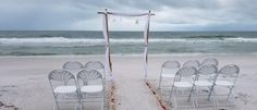 Sweet and Simple Bamboo Poles with white draped fabric. Simple beach wedding setup. Florida notary wedding officiant. Clearwater Beach Wedding Ceremony. Tallahassee Wedding officiant. Simple weddings.