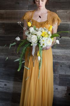 unique bouquet shape, photo by Buena Lane, flowers by Lilify http://ruffledblog.com/western-nomadic-styled-shoot #bouquet #flower #yellow