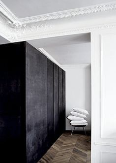 Love the dark and rich panelled volume cupboards. Good marriage of old and contemporary.  #blackcupboards #cupboards #wardrobe
