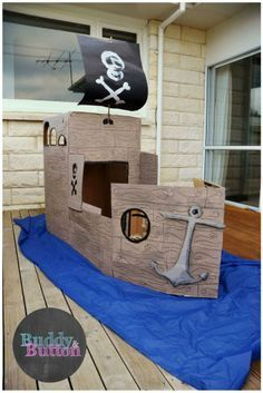 DIY cardboard pirate ship. Anchor out of cardboard and foil .