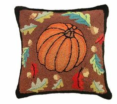 Great Pumpkin Pillow: Not only will this pumpkin pillow work great for Halloween but it would also be wonderful all throughout the Fall Harvest season. This 100% wool hooked pillow has an oak leaf and acorns border and huge orange pumpkin in the center. Featuring the colors of Autumn with reds, oranges, and browns this pillow is a classic.