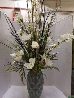Tall arrangement for your home or business entryway with cream and white flowers. Designed by Mary Bui for Michaels Store in Mission Viejo, Ca.