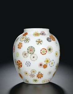 A FINE AND EXTREMELY RARE PAIR OF FAMILLE-ROSE 'FLOWER-BALL' JARS SEAL MARKS AND PERIOD OF QIANLONG