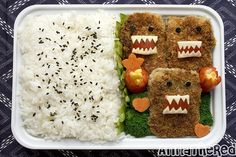 A Domo Bento! Wondering if I could copy this for the boy... he'd love it. Maybe with my gluten free vegan mini-meatloaf recipe, ketchup & cheese?