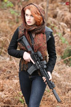 Em with a Gemtech TREK suppressor equipped AR-15 rifle, featuring the Centurion Arms C4 rail system which clamps directly onto standard barrel nuts