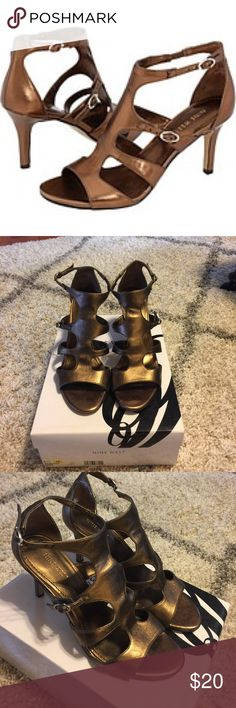 """Nine West 'Tinker Toy' bronze sandals heels GUC; a couple gauges one on the back of the right heel and one on the back of the left heel; otherwise in good condition; super comfy; 3.5"""" heel; smoke free pet free home. Nine West Shoes Heels"""