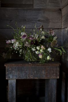 Great flowers with reclaimed wood.