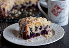 Tender, moist lemon coffee cake loaded with blueberries crowned with a crunchy, sweet crumb topping and drizzled with a tart lemon glaze. A fun way to change up blueberry muffins.