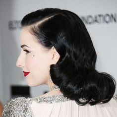 Dita Von Teese From the Side  Note the way Dita Von Teese's retro-esque waves elegantly graced her back and shoulder at Elton John's annual event.