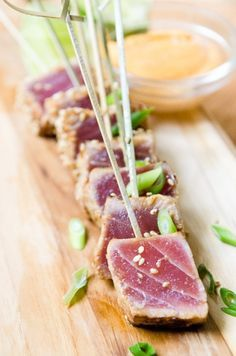 Ahi Tuna Skewers with Sriracha Aioli…………… ((STEAK)) ahi tuna steak, rice wine vinegar, ginger, grape seed oil, sesame oil, low sodium tamari, honey, sriracha sauce, Toasted sesame seeds and scallions for garnish ((AIOLI SAUCE)) aioli, Sriracha, lime juice, 2 scallions, kosher salt