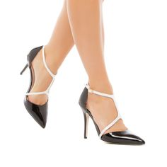 Ryane - ShoeDazzle This pointed-toe pump from the SIGNATURE collection strikes a voguish silhouette. Ryane includes T-strap styling and an insole comfort pad for luxe wearability.