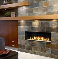 Gas fireplace--mantel, lights... small fireplace with no hearth that takes up floor space