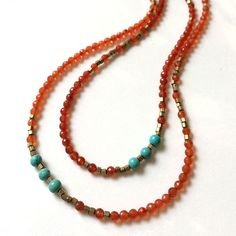 """Carnelian Long Necklace by Alexia Viola Napa Valley. 46"""" necklace features beautiful, Carnelian accented with two trios of smooth Turquoise beads. Finished with signature leather and brass clasp. Can easily be worn long, or doubled, even tripled! American Made. See the designer's work at the 2015 American Made Show, Washington DC. January 16-19, 2015. americanmadeshow.com #necklace, #jewelry, #carnelian, #turquoise, #red, #americanmade"""