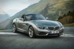 The new BMW Zagato Roadster.  19-inch light-alloy wheels, an exclusive gray exterior paint finish, brown, leather-wrapped roll bars inspired by airplane design, and a more elegant tail end.
