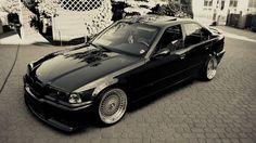 BMW e36 sedan on AWESOME Custom 3 piece OEM BMW Styling 17 wheels