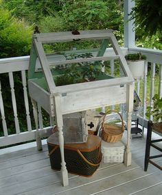 Take a couple of old windows, table legs, and an old crate to make a perfect upcycled greenhouse for the porch.