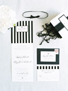 Elegant and modern invitation suite with black & white stripes. Wedding stationery