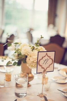 Black and gold glitter reception table number cards | photography by http://www.leighmillerphotography.com/