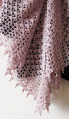 """Baked milk is a feminine triangle-shaped shawl worked in three different shell stiches. Size is easily adjustable and also depends on yarn you use. This design looks beautiful both in fine and thick yarn. Pattern both written and charted. Finished size: wingspan 71"""" (180 cm), depth 35.5"""""""