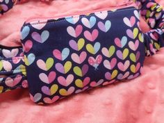 Multi color hearts lovebug on Navy Blue Insulin Pump Pouch #insulinpumppouch #custommadeinsulinpumpcases #childrensinsulinpumppouches #type1diabetes #dazzlingpumppouches