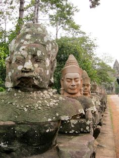 By Tom Crosby Angkor Wat – Cambodia's Heart and Soul For most tourists, the landmarks that litter their photo albums define the lands they've visited. From Paris to Peking, it's the Eiffel Tower an… Angkor Wat Cambodia, Places To Travel, Statue, Travel Destinations, Destinations, Sculptures, Sculpture